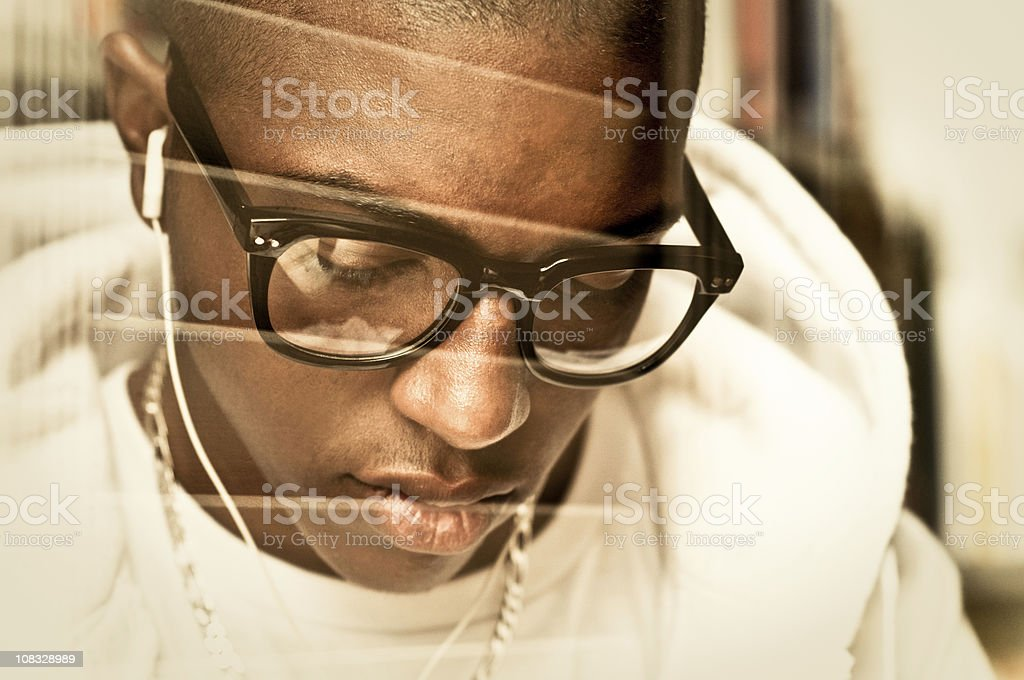 Afro-American Teenager listening to music royalty-free stock photo