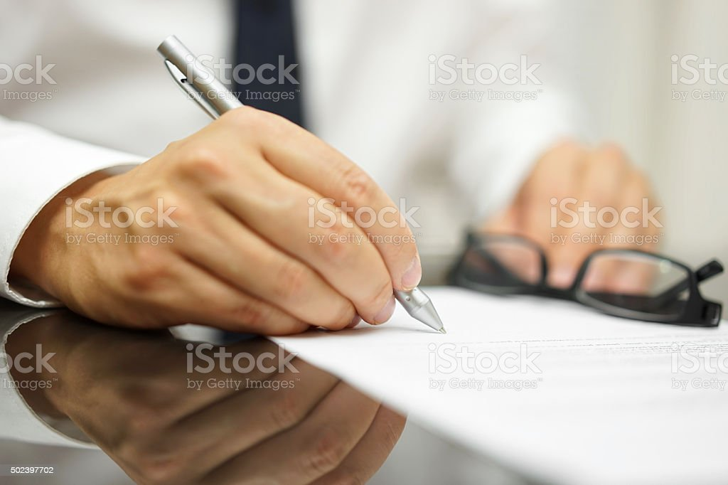 After a review of the sales contract Businessman finished deal stock photo