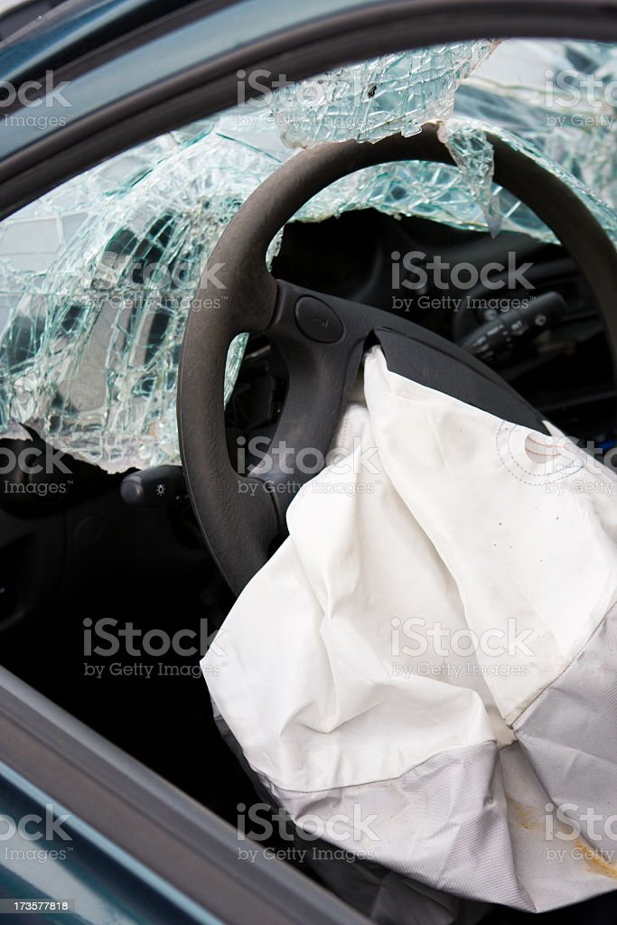 After affect of a car accident showing a deployed airbag stock photo