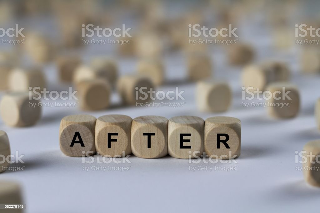 after - cube with letters, sign with wooden cubes stock photo