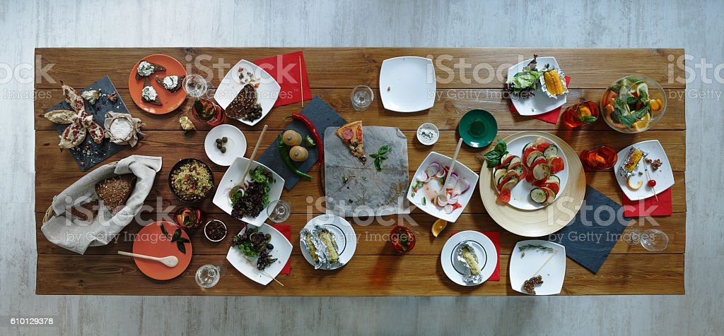 After party. Wasted food on wooden served festive table stock photo