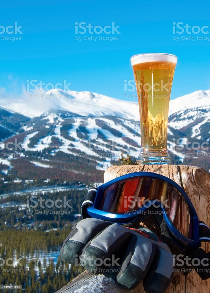 After Skiing Refreshment. Beer and Gear with Mountains. royalty-free stock photo