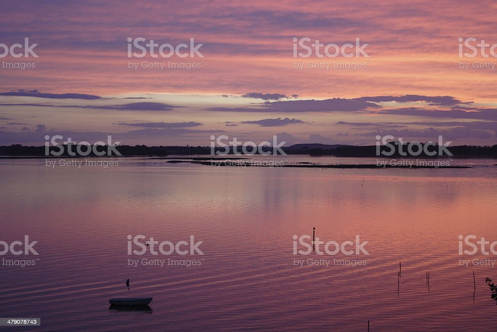 After sunset over the fjord - pink sky stock photo