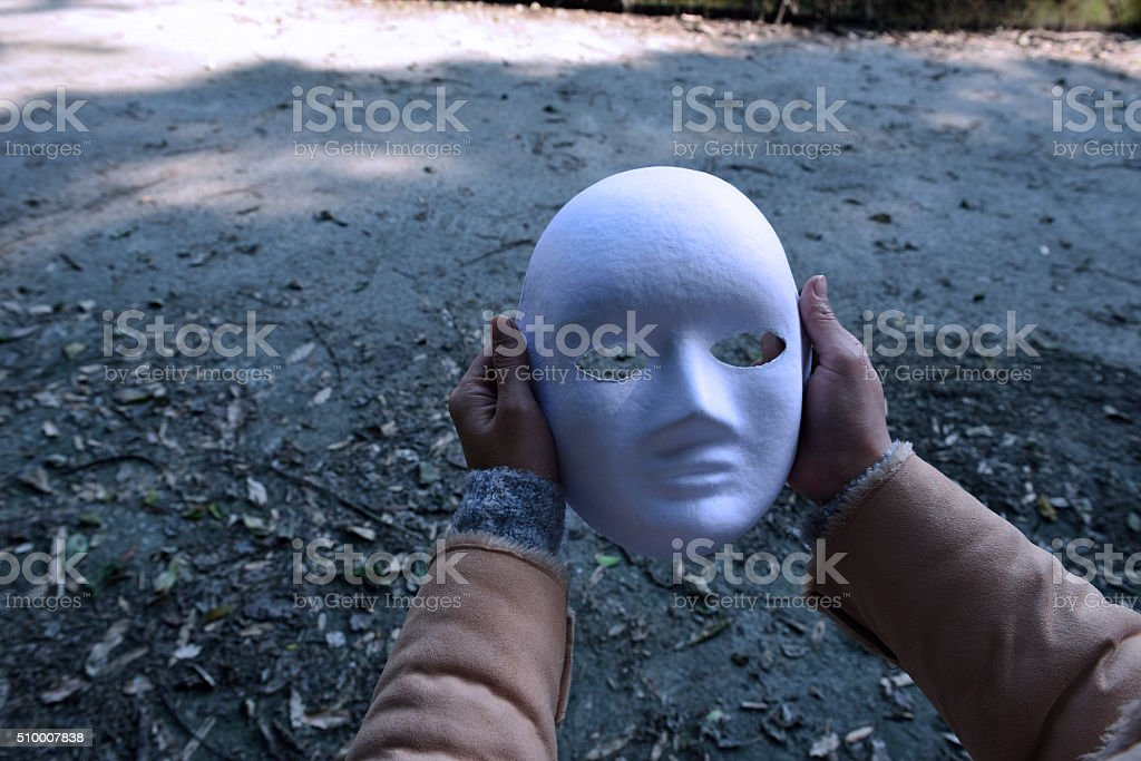 After take off the mask, who am I? stock photo