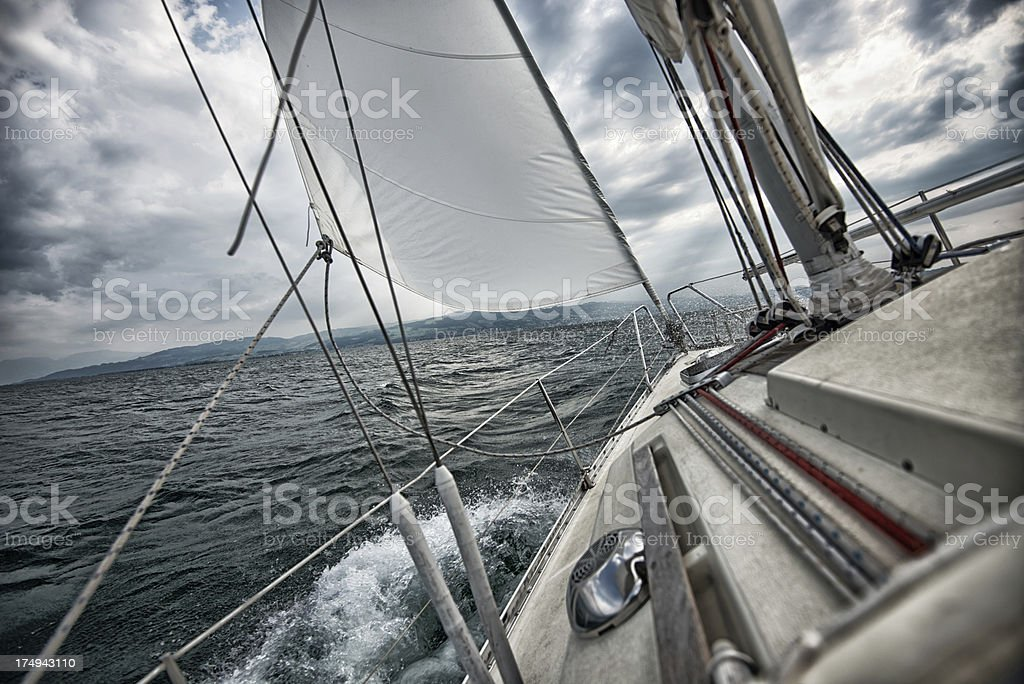 after the storm sailing into sun stock photo