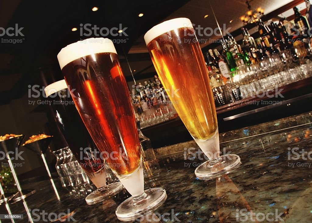 After Work - Beer in Frosted Glasses on Granite Bar royalty-free stock photo