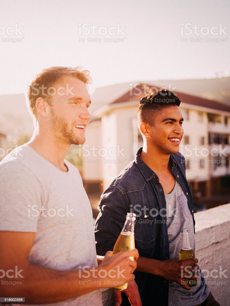 After work hang out on rooftop for two friends stock photo
