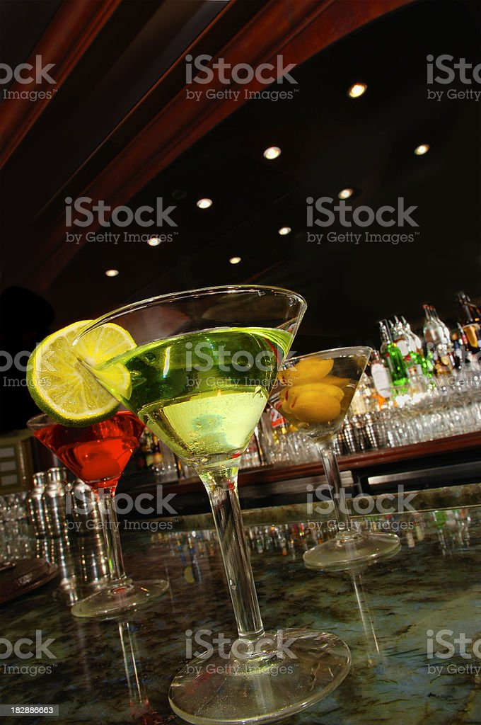 After Work - Martini Glasses Reflecting on Granite Bar stock photo