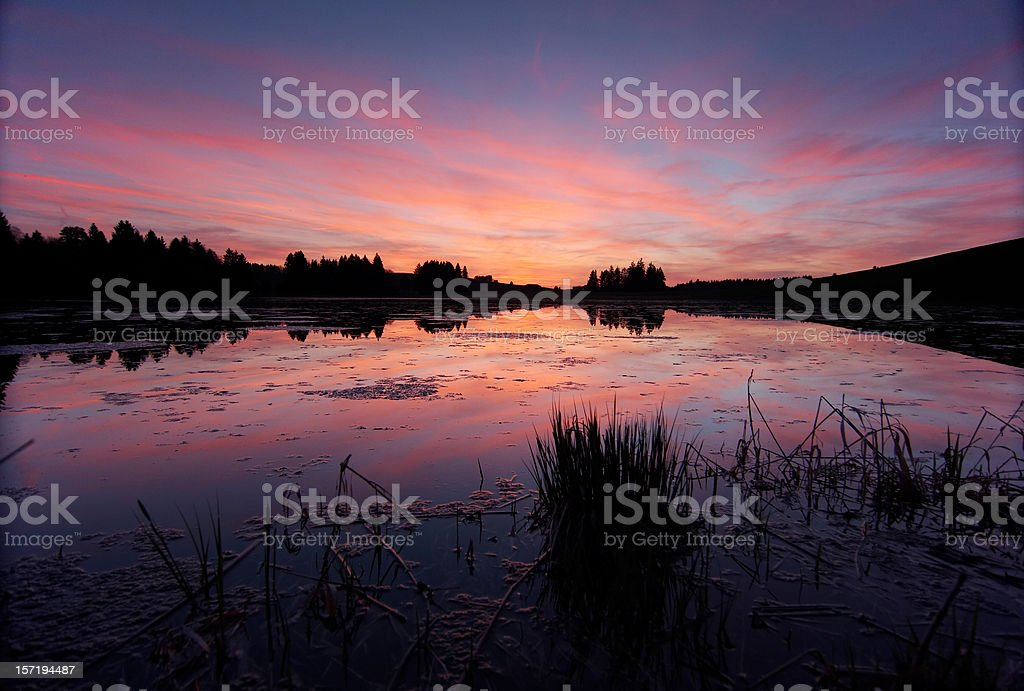 afterglow at a lake in bavaria- germany royalty-free stock photo