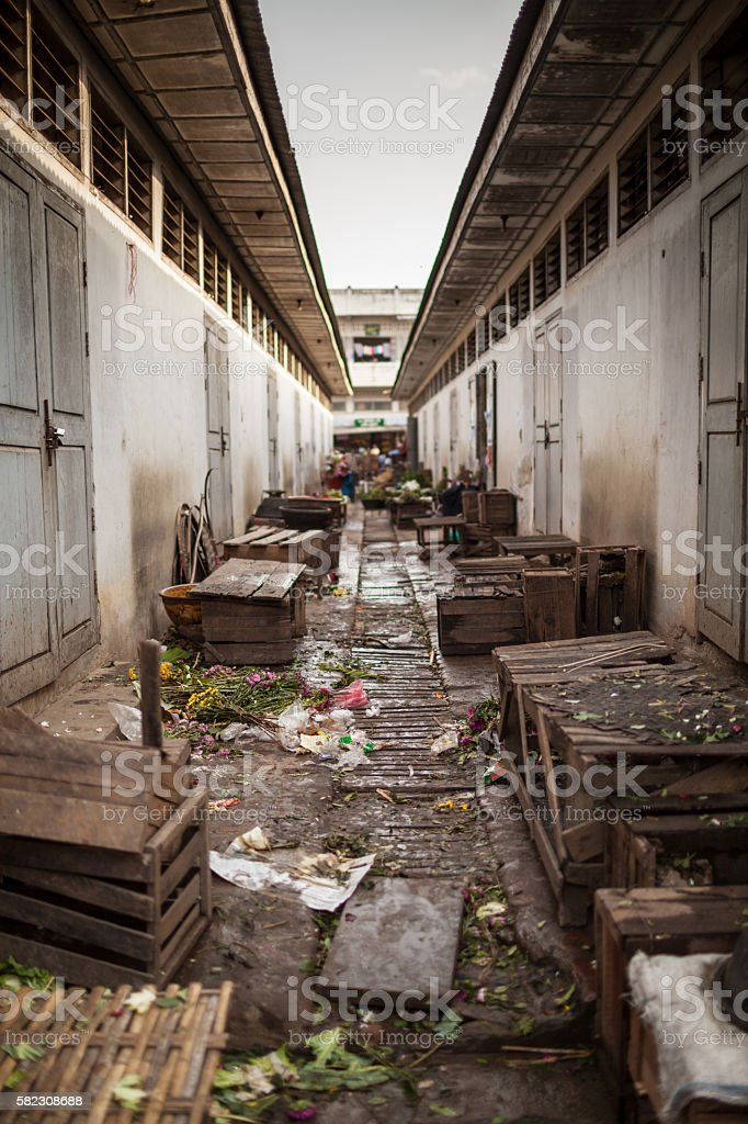 Aftermarket alley full of garbage and crates stock photo