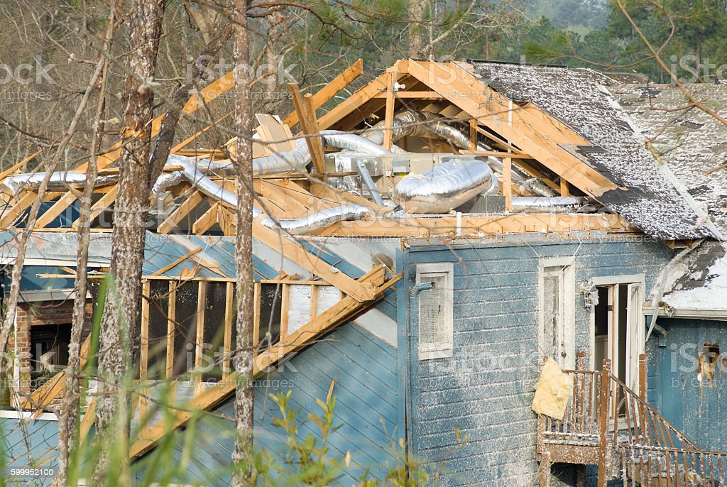 Aftermath of a tornado damaged wood framed house stock photo