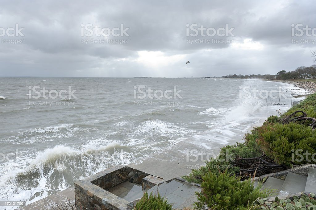 Aftermath of Hurricane Sandy, waves crashing on shoreline stock photo