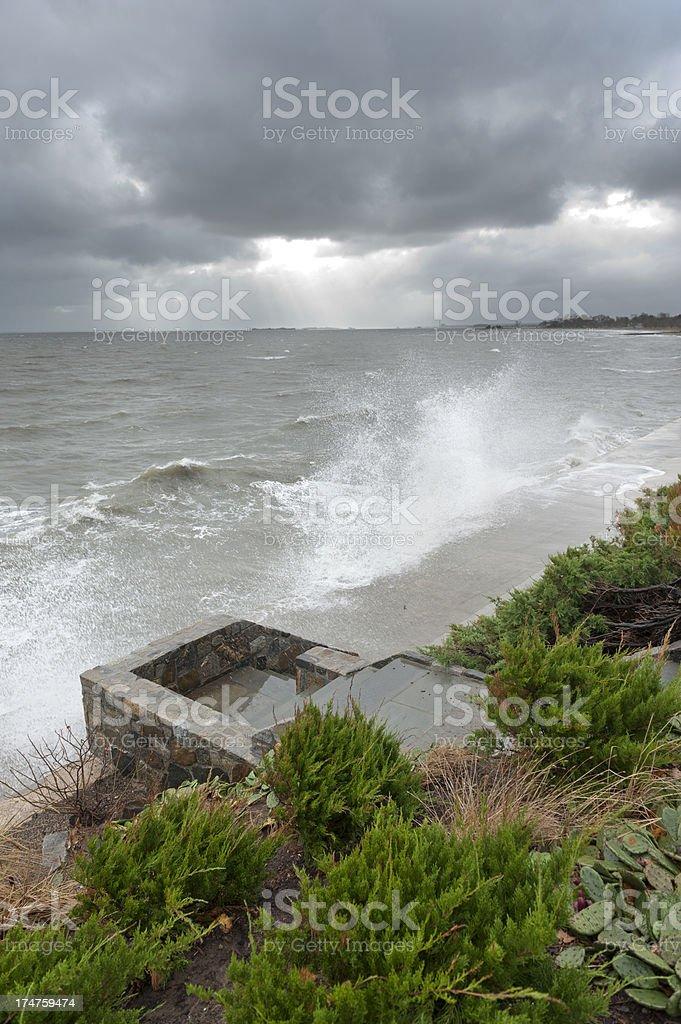 Aftermath of Hurricane Sandy, waves crashing on shoreline stock photo