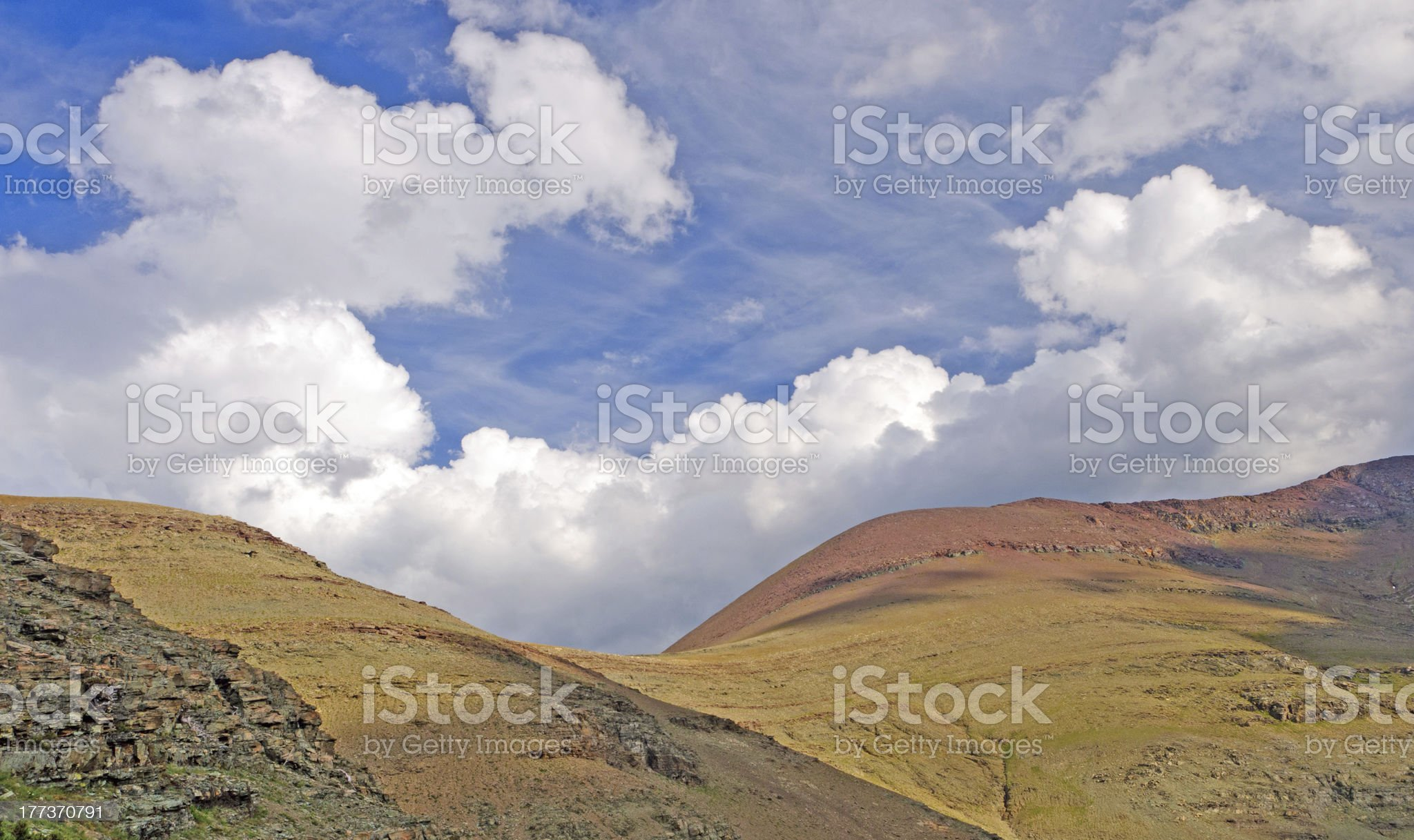 Afternoon clouds over a Mountain Pass royalty-free stock photo