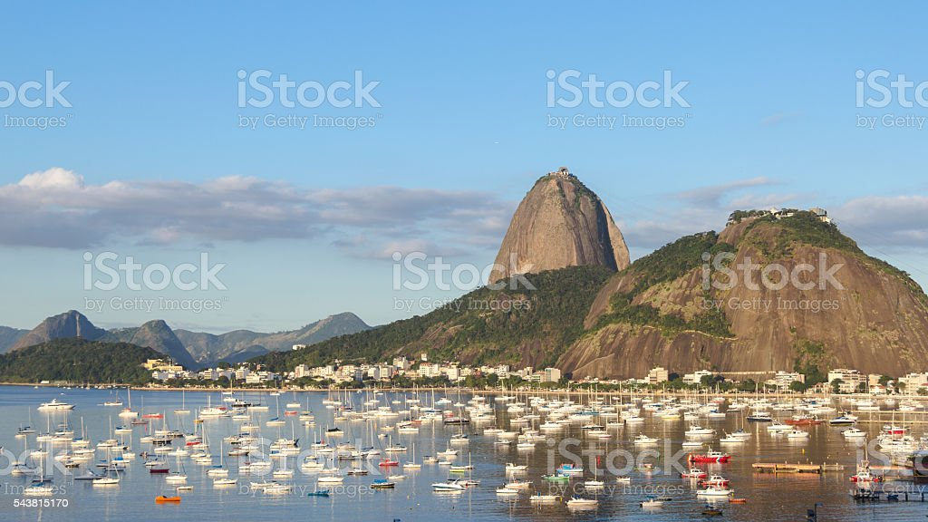 Afternoon in Guanabara Bay. Urca Mountain and boats stock photo
