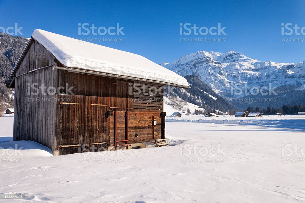 Afternoon sun barn and Wildstrubel Mountain, Swiss Alps royalty-free stock photo