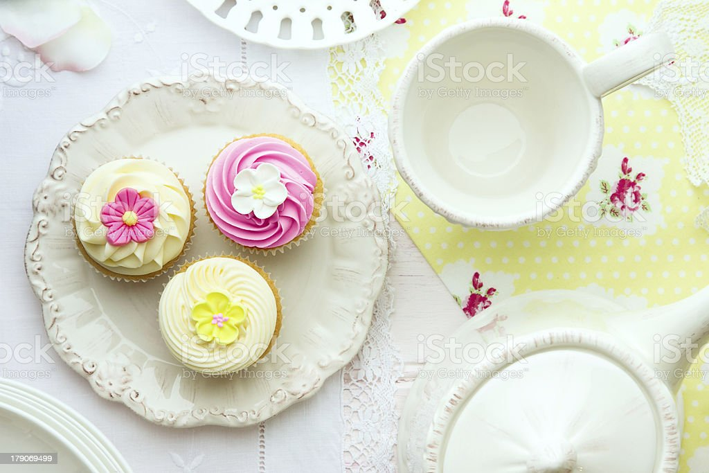 Afternoon tea and cupcakes served on a table stock photo