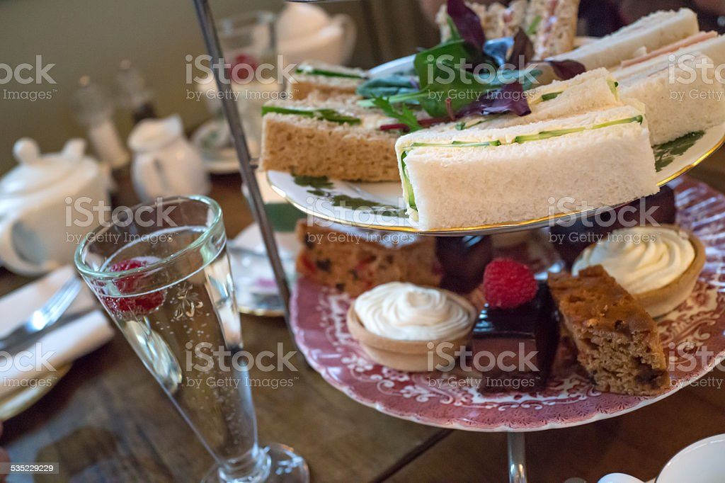 Afternoon tea - Champagne, sandwiches and cakes stock photo