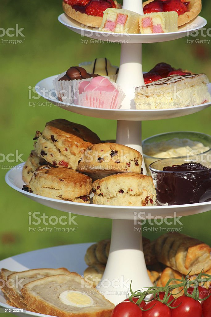 Afternoon tea / cream tea, tiered cake stand, sandwiches, cakes, scones stock photo