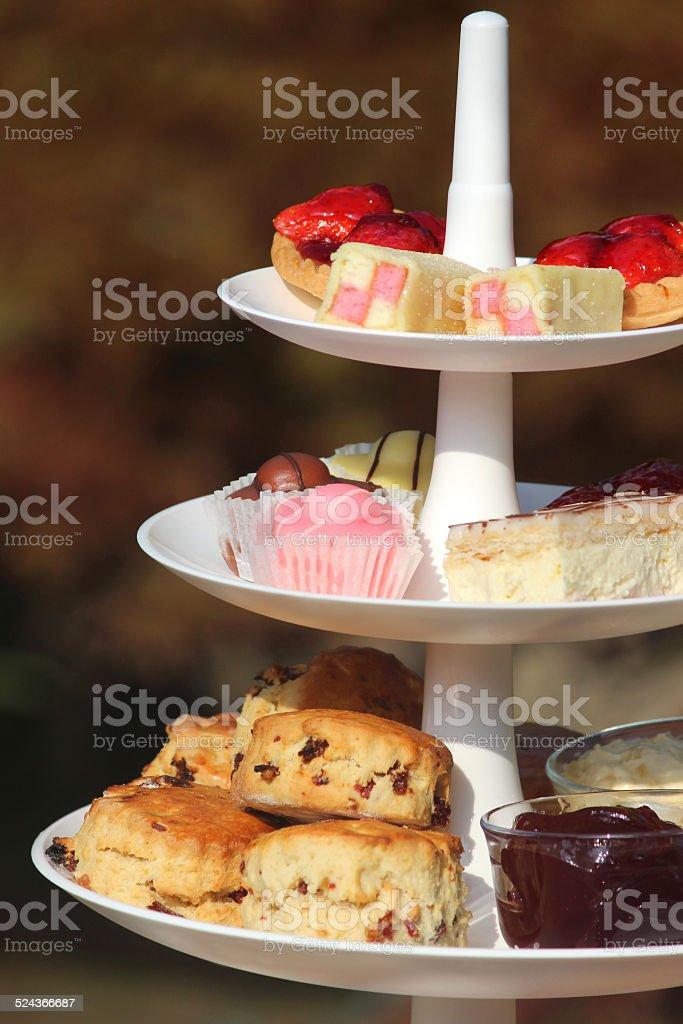 Afternoon tea / cream tea, tiered cake-stand, cakes, scones, jam, clotted-cream stock photo