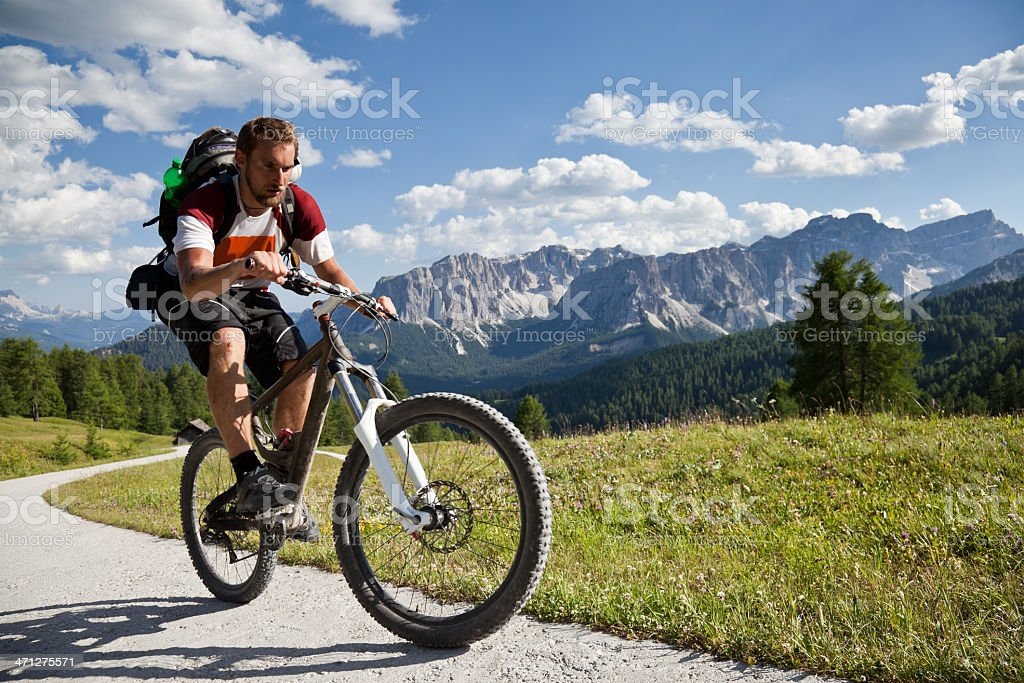 Afternoon uphill biking, Dolomites royalty-free stock photo