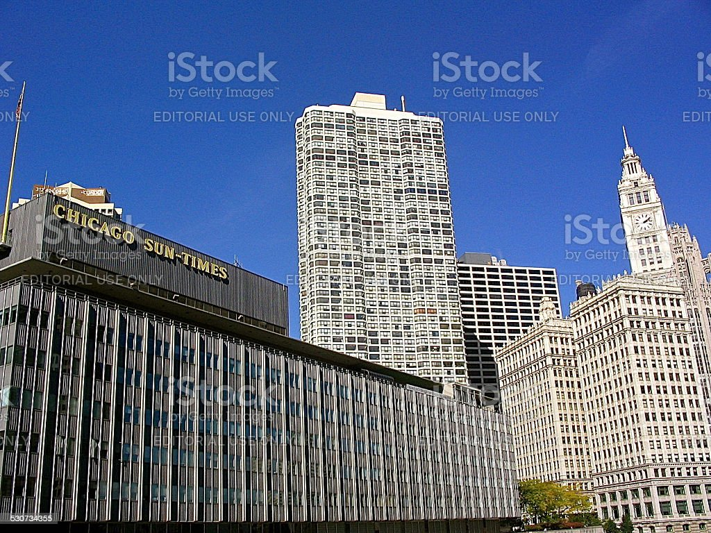 Afternoon view toward old Sun-Times Building, Wrigley Building clock tower stock photo
