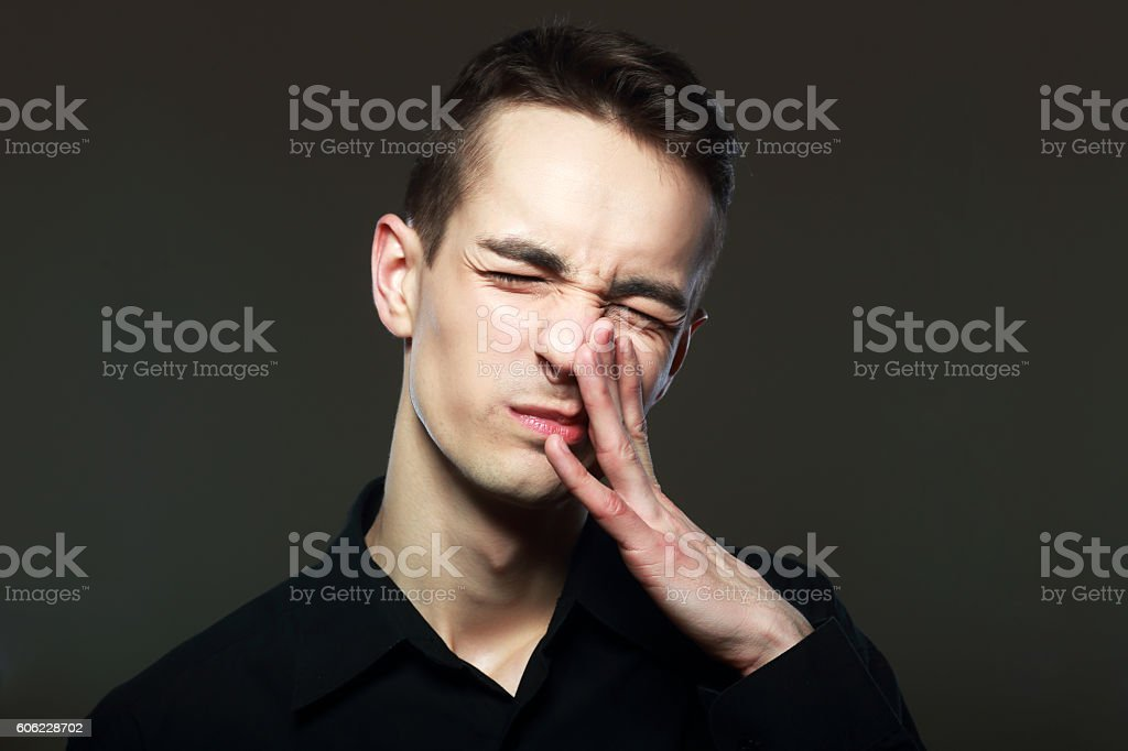 against a bad smell stock photo
