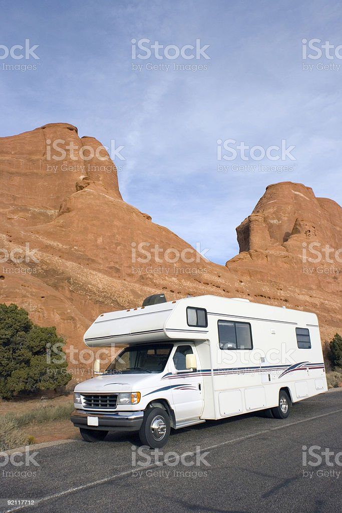 RV against red rock formation royalty-free stock photo