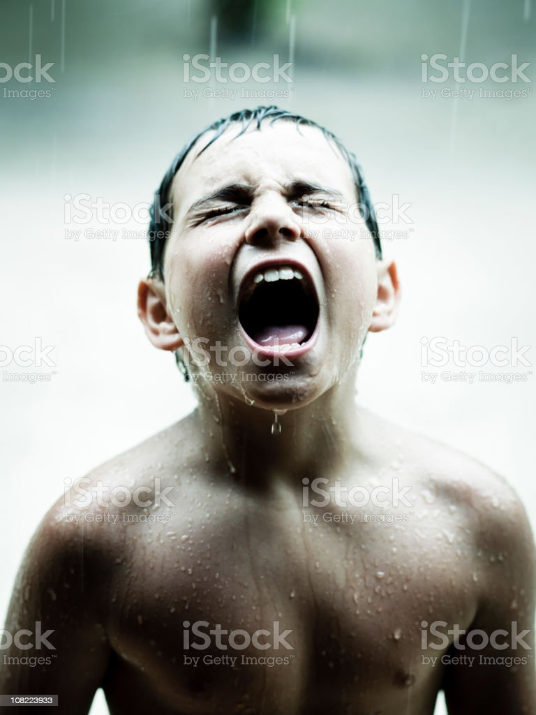Against the Rain, Boy in tropical shower. royalty-free stock photo
