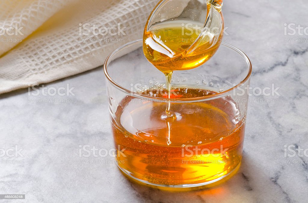 Agave syrup pouring on a glass. stock photo