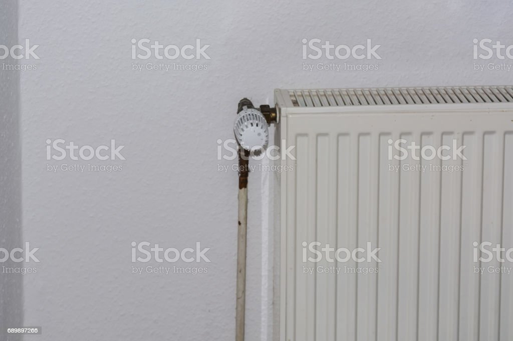 Age plates radiator with thermostatic valve. stock photo