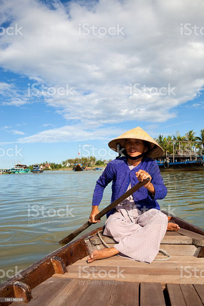 Aged Asian woman wearing tradititional conical hat, Hue, Vietnam royalty-free stock photo