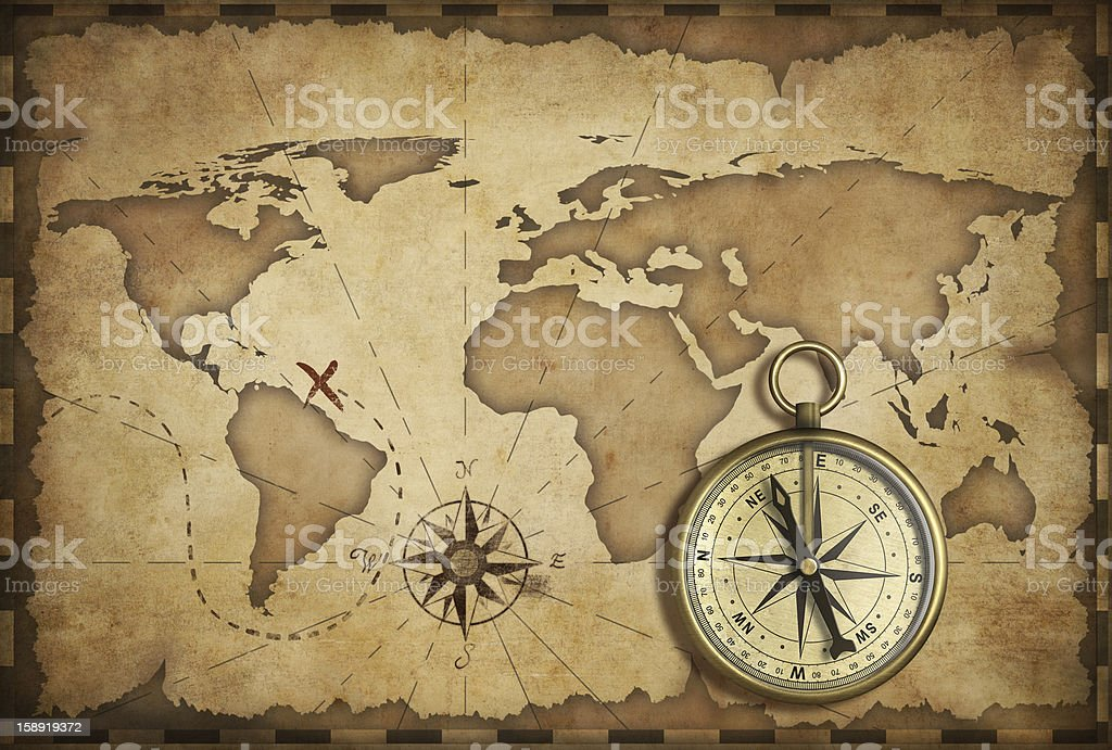 aged brass antique nautical compass and old map royalty-free stock photo