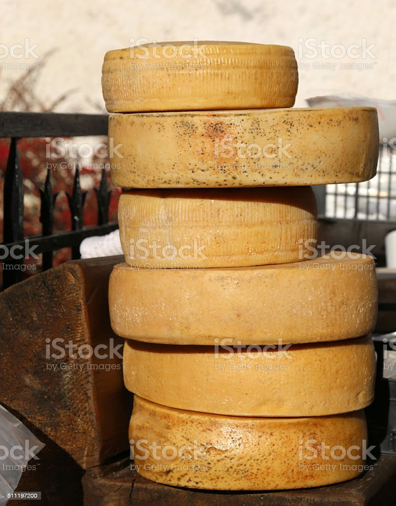 aged cheeses on sale in the market stock photo