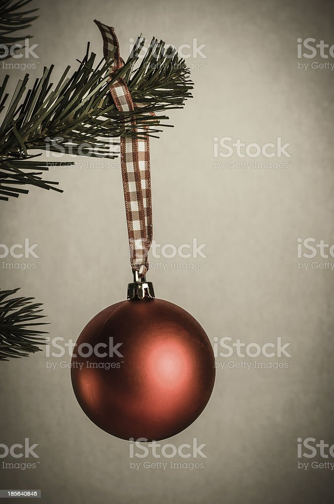 Aged Christmas Bauble on Tree royalty-free stock photo