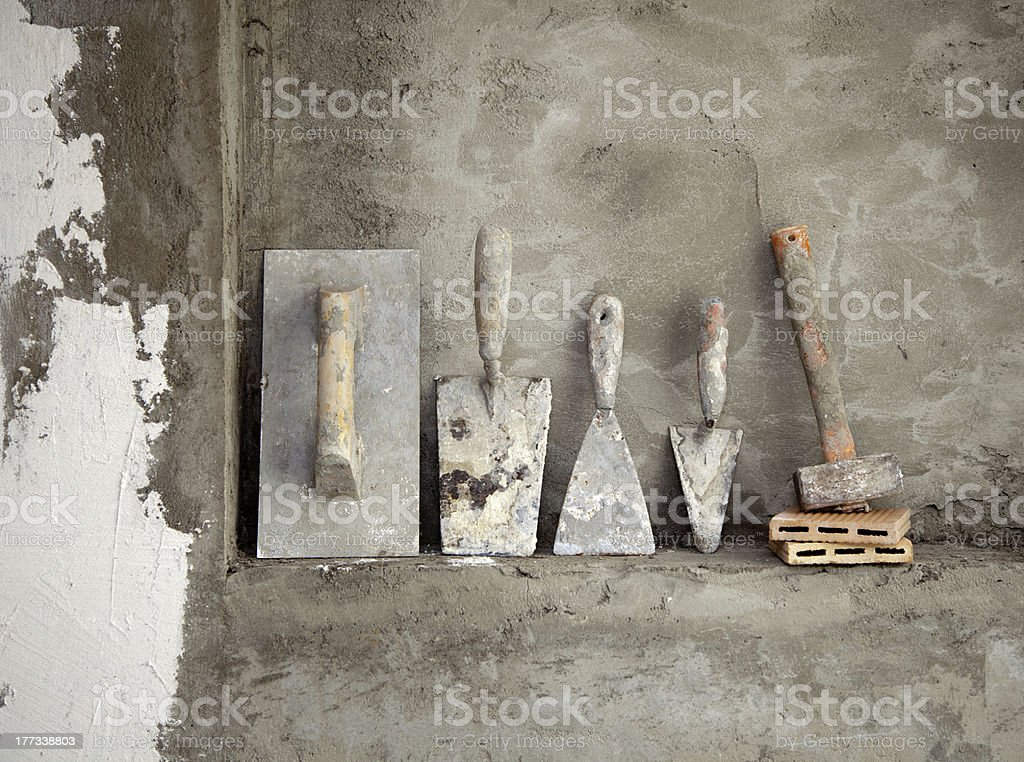 aged construction cement mortar used tools stock photo