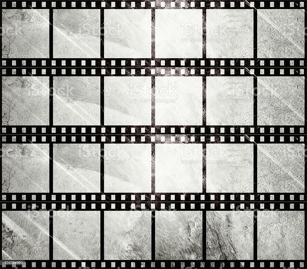 Aged film strip in grunge style royalty-free stock photo