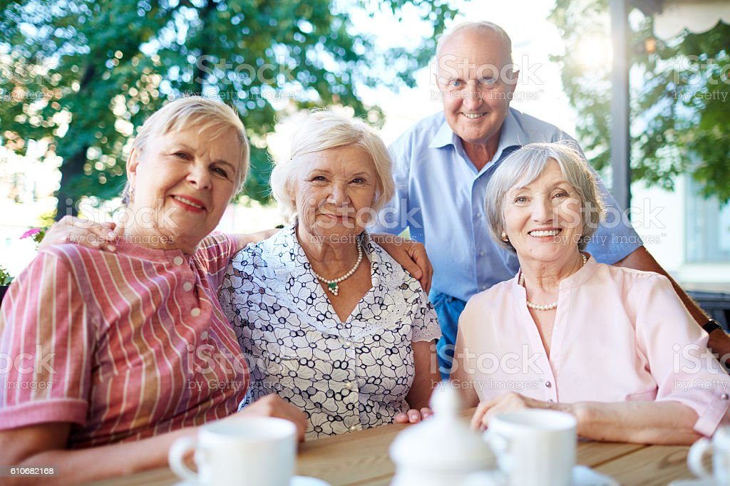 Aged friends stock photo