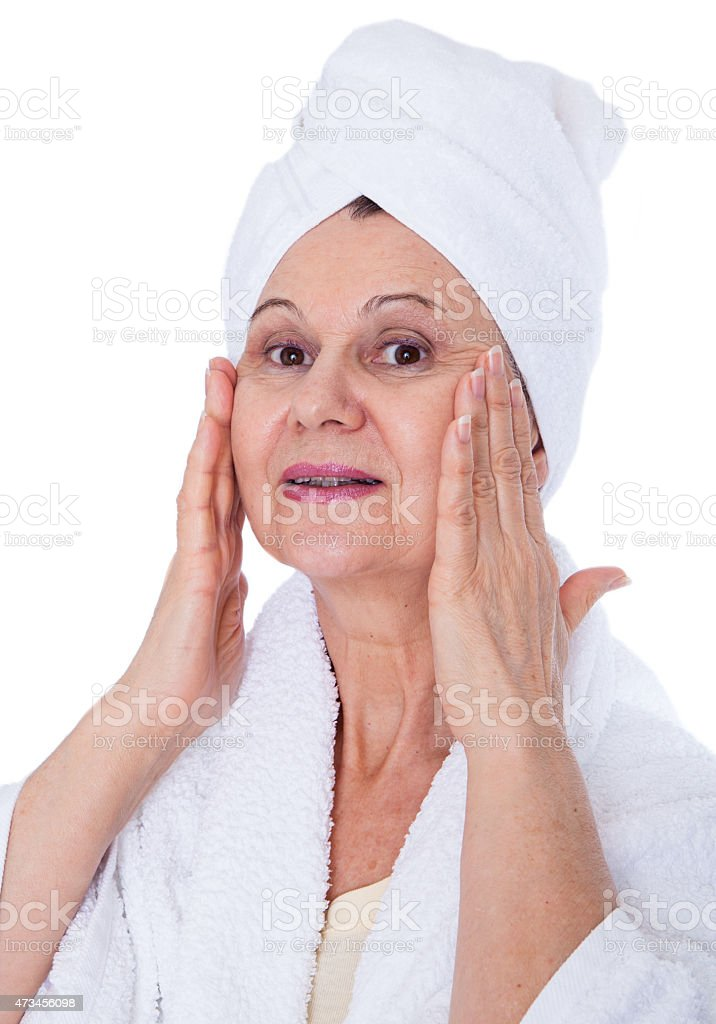 Aged good looking woman in spa stock photo