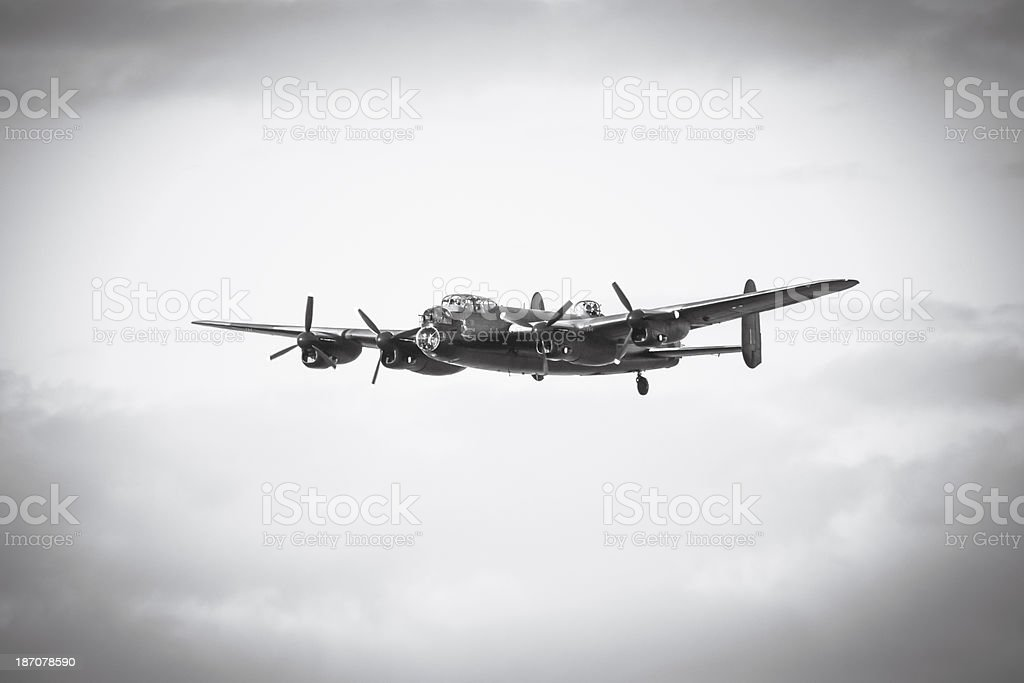 Aged image of an Avro Lancaster in flight wheels up stock photo