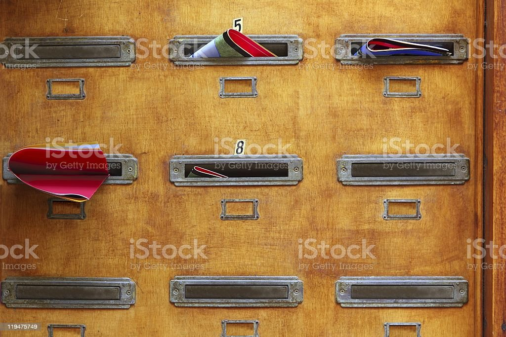aged mailboxes in spain wooden wall rusty brass stock photo