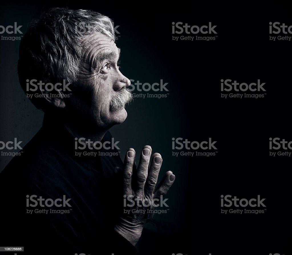 Aged Man Praying-Low Key stock photo