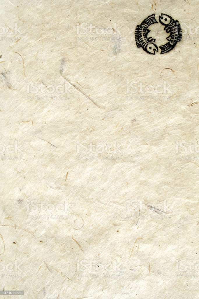 aged nepalese paper: buddhist double fish symbol stock photo