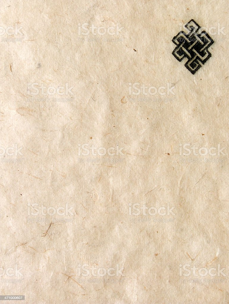 aged nepalese paper: buddhist 'endless knot' symbol royalty-free stock photo