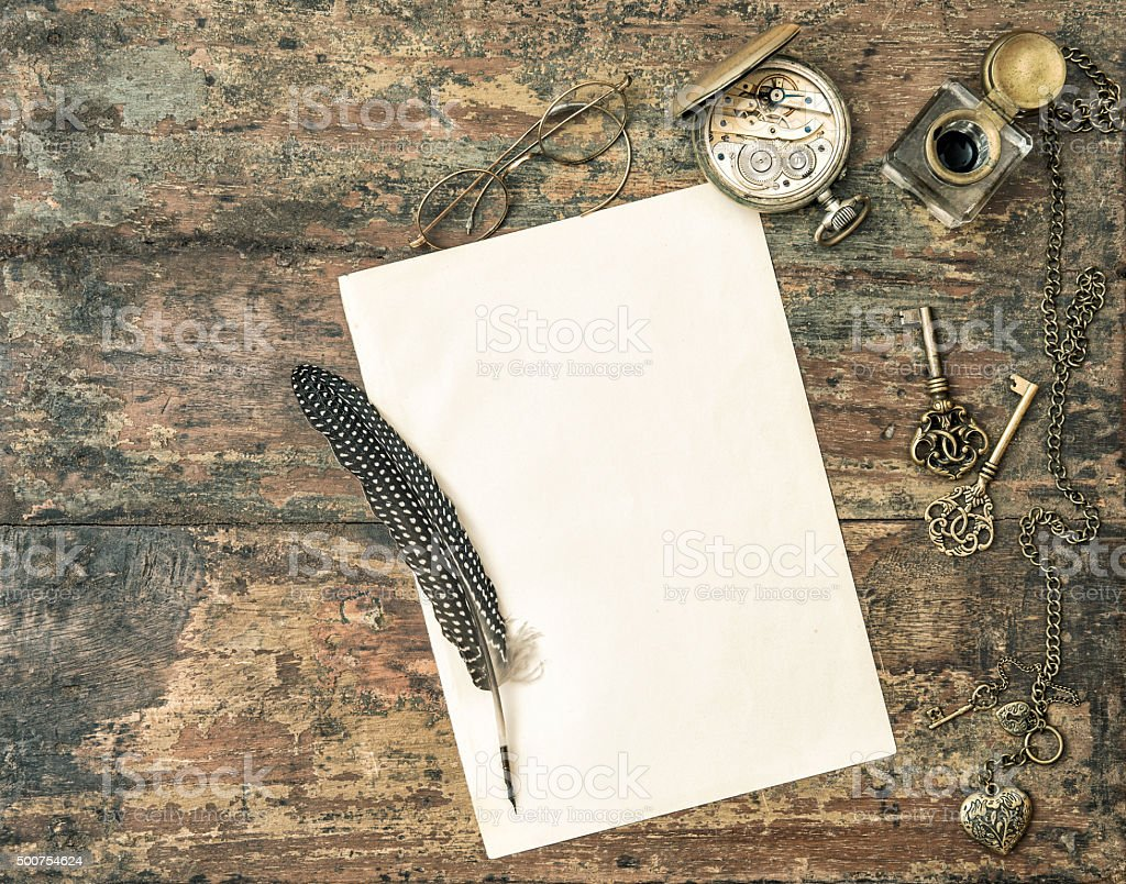 Aged paper and antique writing accessories. Vintage style stock photo