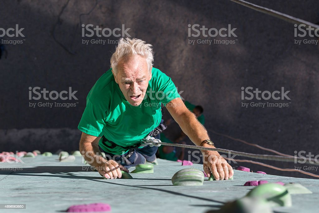 Aged Person Practicing Extreme Sport stock photo