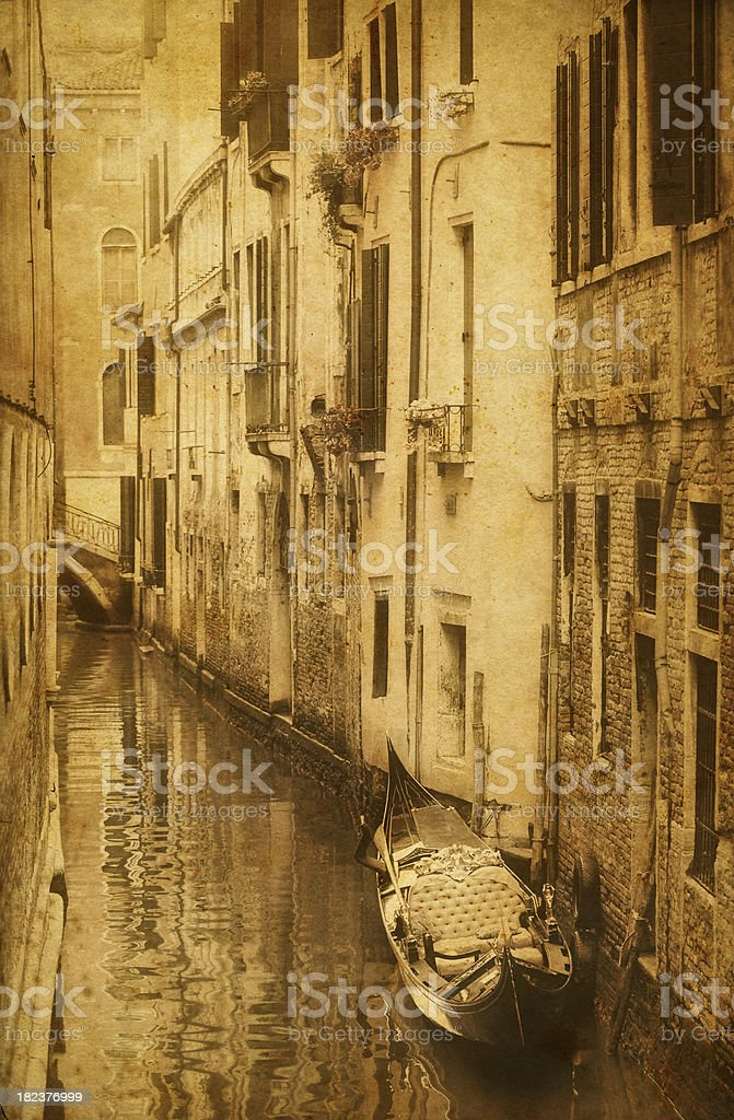 Aged photo of a canal with gondola in Venice royalty-free stock photo