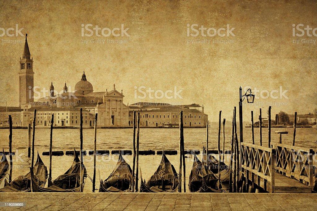 Aged photo of gondolas at Saint Mark's Square stock photo