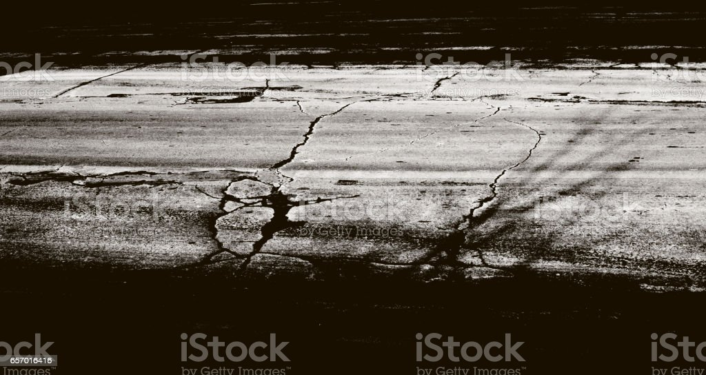 aged road with cracks stock photo