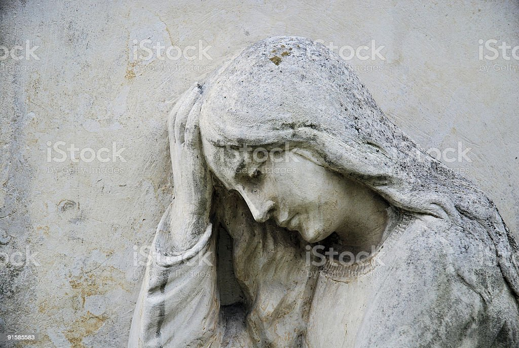 Aged stone Madonna statue background stock photo